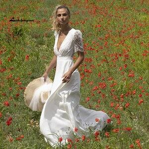 2021 Deep V Neck Lace Puff Short Sleeve Romantic Bridal Wedding Dresses Bohemian Style A Line robe de réception de mariage