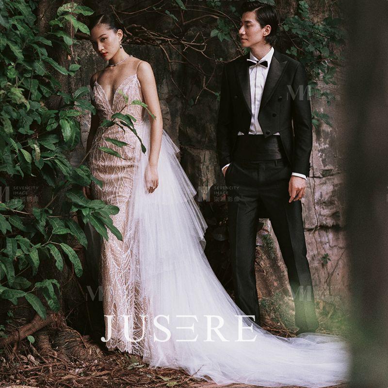Champagne color ball gown spaghetti  v neckline cascading ruffles sequin low v back chapel train wedding dress