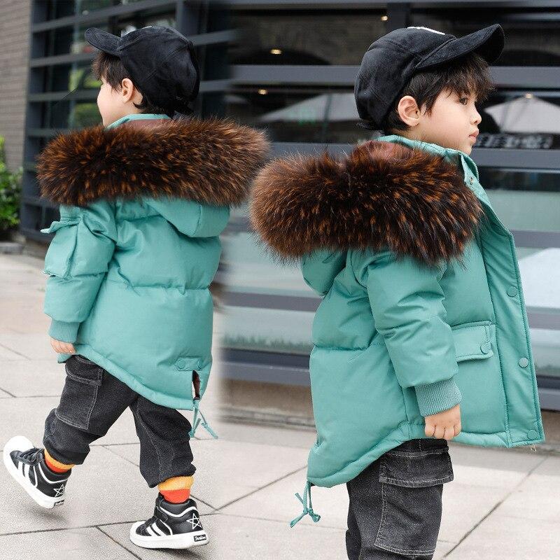 2019 الأطفال أسفل سترة الرجال صغيرة و متوسطة الحجم الأطفال جديد المرأة طويلة الكورية سميكة الصبي معطف