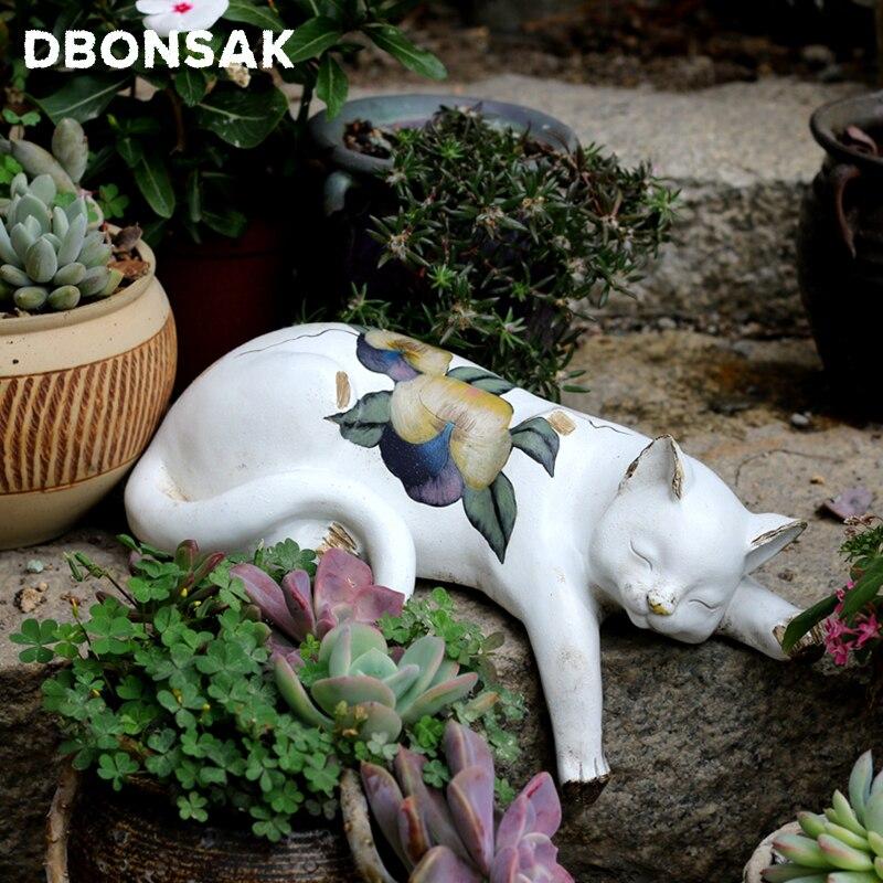 كسول القط النحت الحيوان الأبيض القط تمثال الراتنج زهرة القط كيتي الحديقة المشهد الحيوان الحرف النحت زهرة حامل ديكور