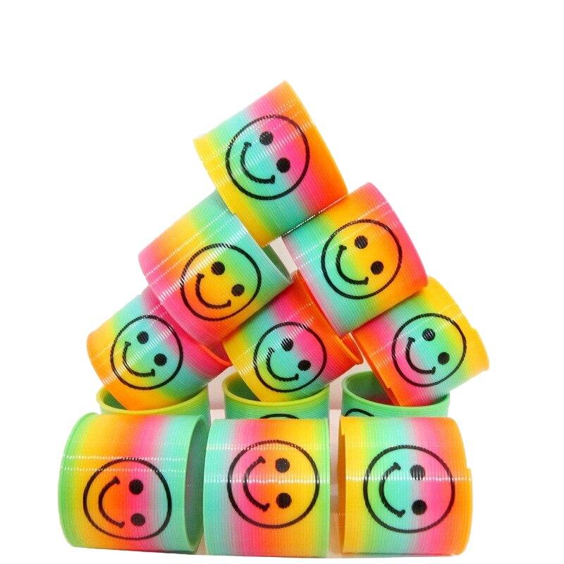 Juego de 10 piezas de juguetes para niños con sonrisa mágica, resorte de plástico, arcoíris de colores, anillos circulares elásticos, regalos para niños, divertidos juegos