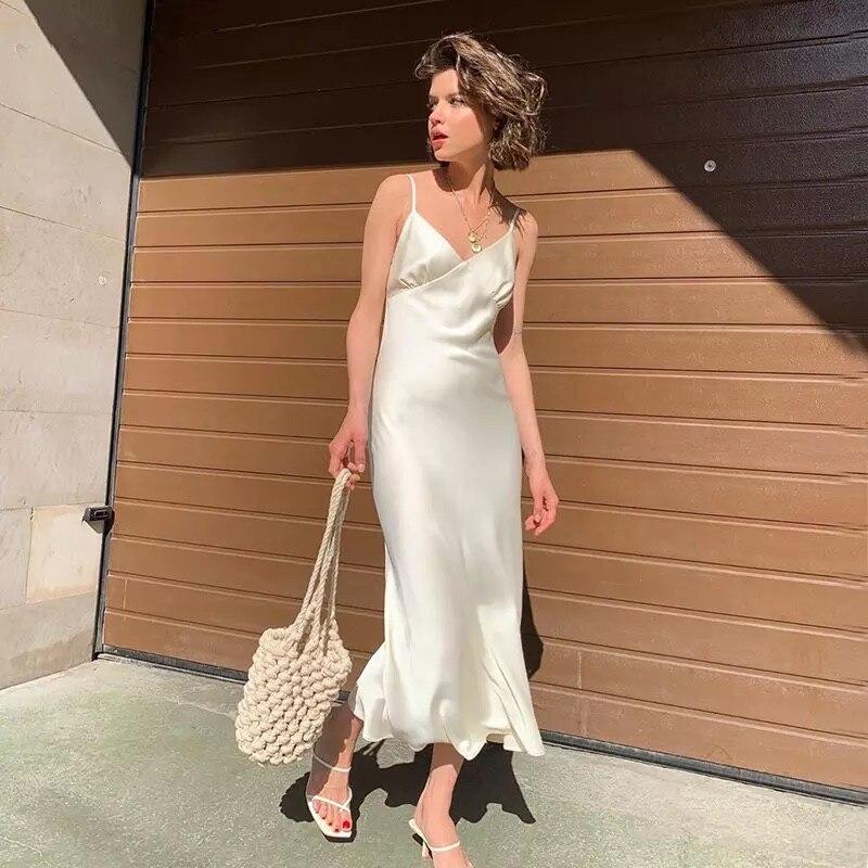 De cuello en V sin mangas vestidos de las mujeres de la correa de espagueti Mid-Calf vaina vestidos de fiesta mujer ropa de verano de las mujeres 2020 nuevo