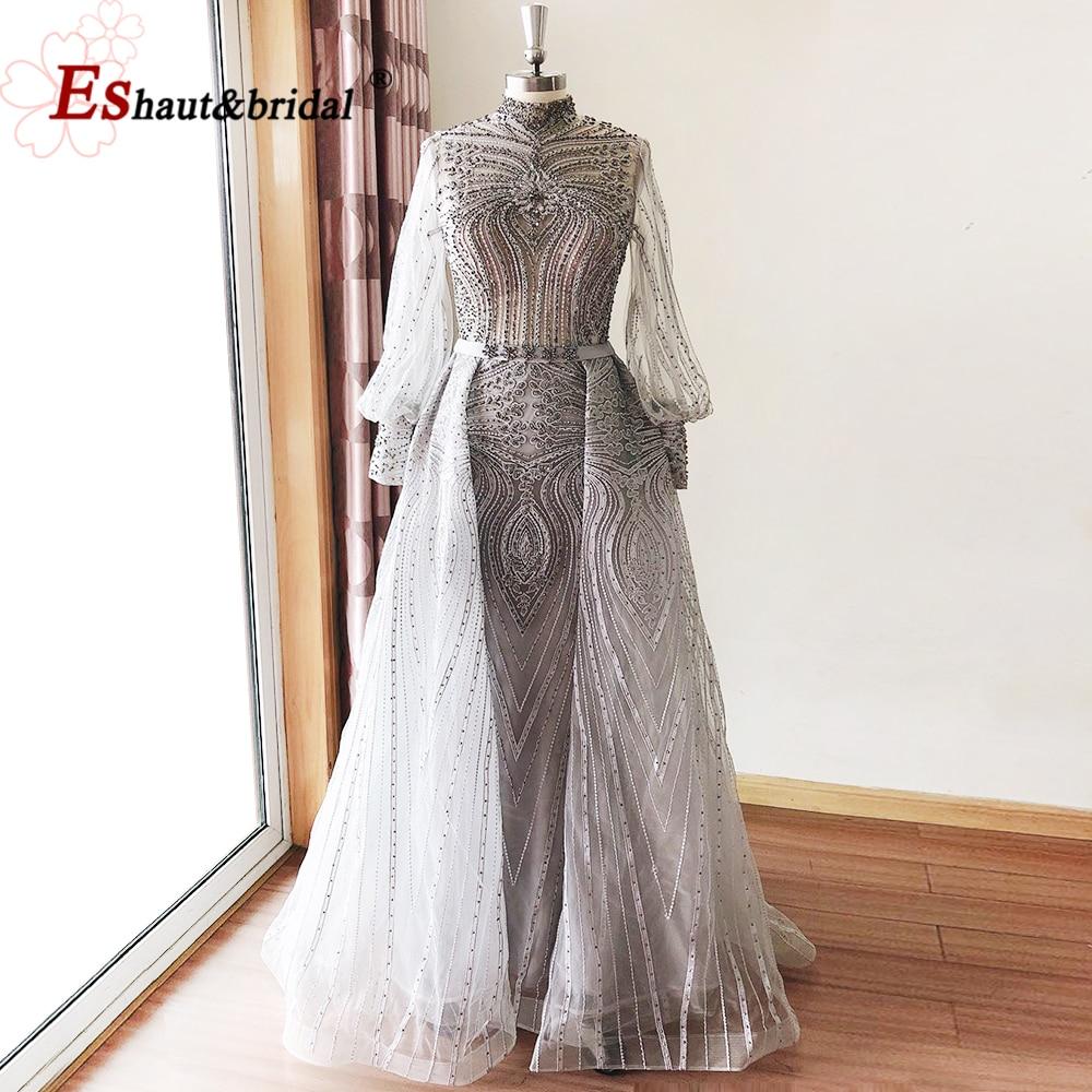 فستان سهرة فاخر من الدانتيل بالكامل في دبي للنساء 2021 بأكمام طويلة واسعة ورقبة عالية من الكريستال يدوي الصنع فستان رسمي للحفلات