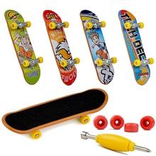 Plastique Mini doigt skateboard touche jouets doigt Scooter Skate embarquement classique Chic jeu garçons bureau jouets Mini outils