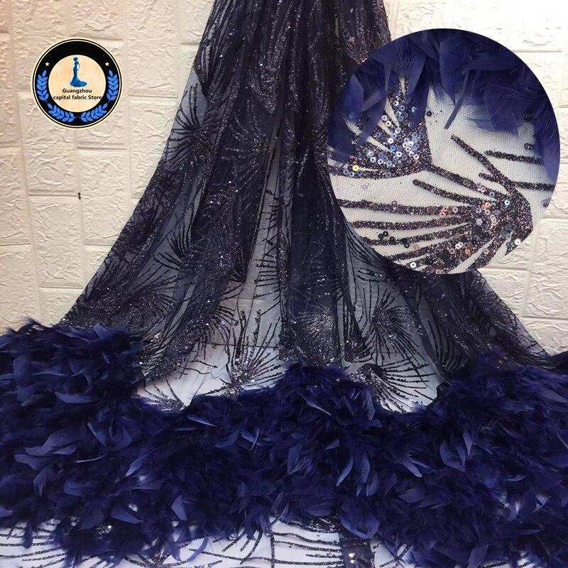 Nueva tela de encaje de África de alta calidad con aplique de pluma manual de tul francés de encaje de lentejuelas de tela usada para mujeres vestido de novia