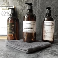 Shampooing presse bouteille liquide Gel douche rechargeable Portable en plastique vide distributeurs de savon Style nordique salle de bain pot 250 500ML