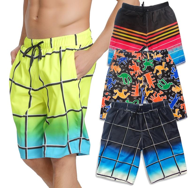 Pantalones cortos para hombre de verano de secado rápido para la playa pantalones cortos deportivos casuales grandes troncos de moda de verano Capri suelto-Fit las parejas de cierre