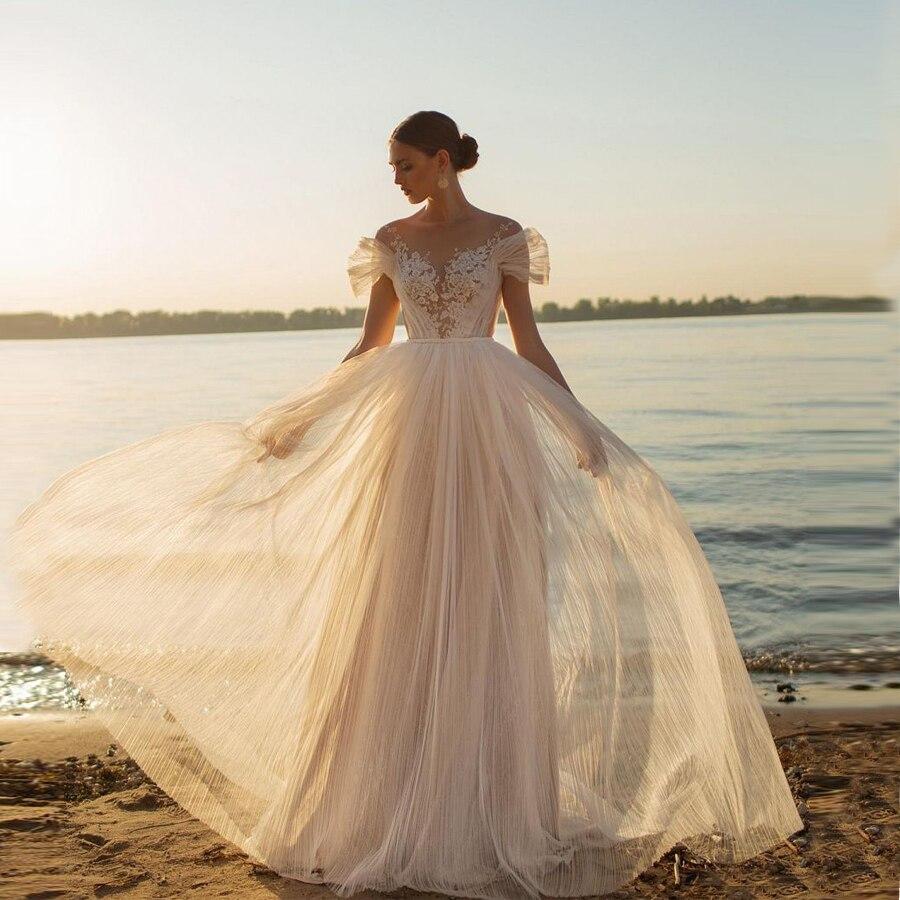 فستان زفاف من التول مع دانتيل ولؤلؤ ، رقبة مستديرة ، خط a ، 2020 ، زر خلفي ، ذيل ، فستان زفاف
