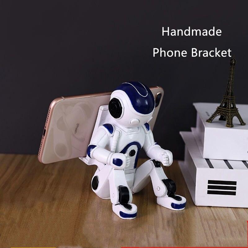 Soporte para teléfono con forma de astronauta, soporte para móvil de resina de Color blanco, decoración moderna para el hogar, estuche de exposición para teléfono