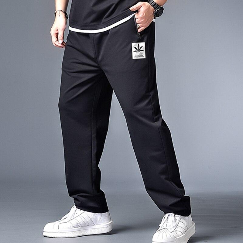 Homens de alta qualidade harajuku jogger street wear homens bolsa de bolso calças harem calças masculinas outono imprimir coreano calças de grandes dimensões