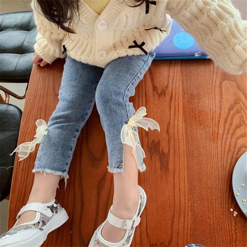 От 2 до 7 лет джинсы для мальчиков и девочек, Элегантная блузка с бантом милые джинсовые штаны с милыми бантиками; Большие размеры стрейч милые весенние детские брюки для маленьких детей, ночное белье в уличном Джинсы    АлиЭкспресс