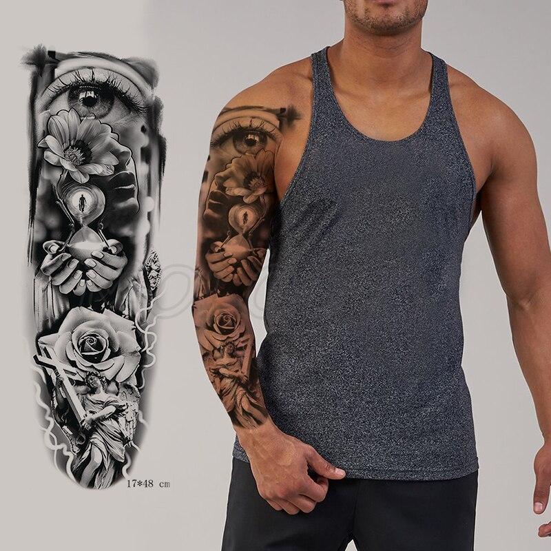 Tatuaje adhesivo temporal brazo completo ojo grande flor Jesús Cruz reloj de arena a prueba de agua mano destello de tatuaje falso niño chica tatuaje