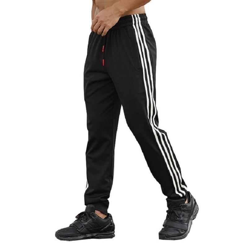 Moda Casual pantalones hombres pantalones ajustados Deporte Pantalones de chándal a rayas gimnasio pantalones cremallera bolsillos pantalones delgados hombres de talla grande M-XXXL