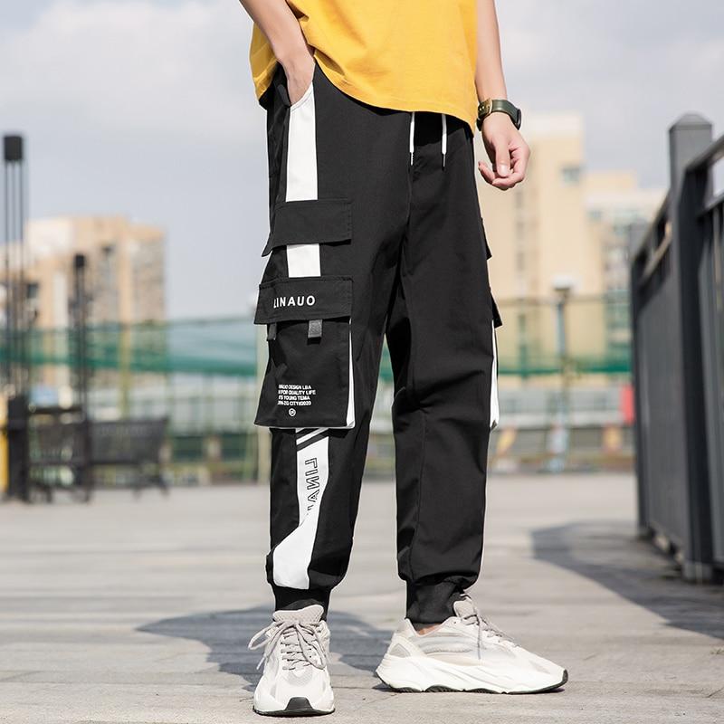 Tuta da uomo con tasca laterale pantaloni da jogging casual neri pantaloni da uomo primaverili ed estivi pantaloni pantaloni da uomo casual da strada