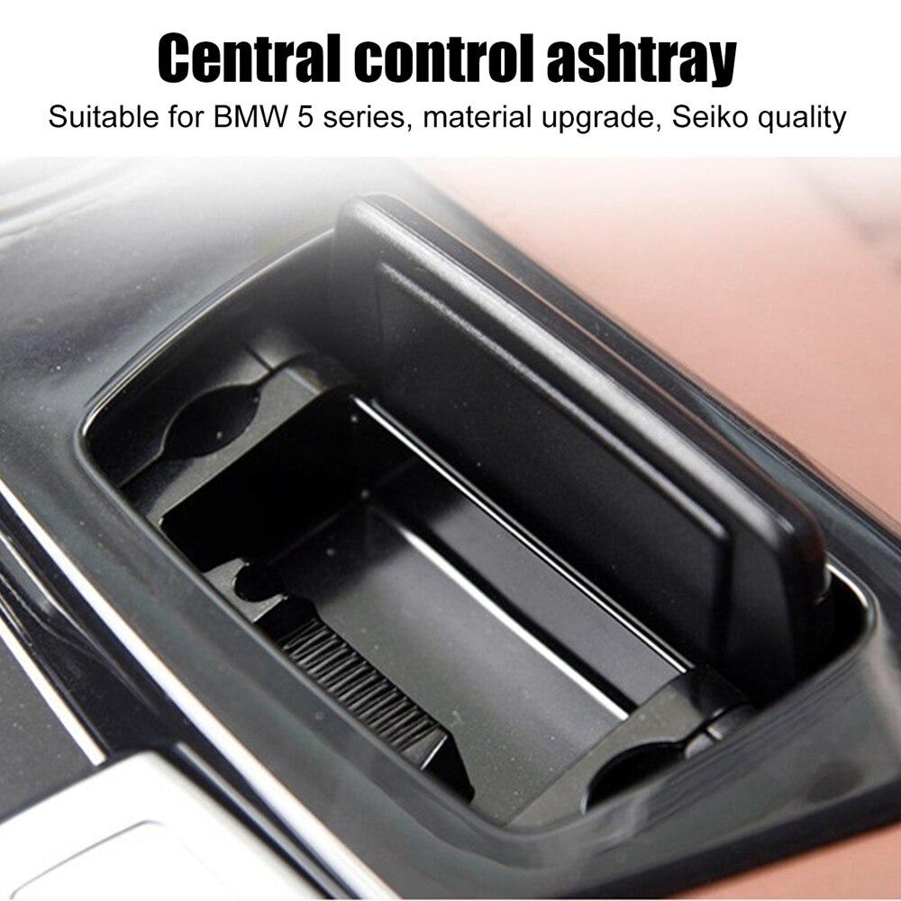 Nueva caja de ensamblaje de Cenicero de consola central de plástico negro...
