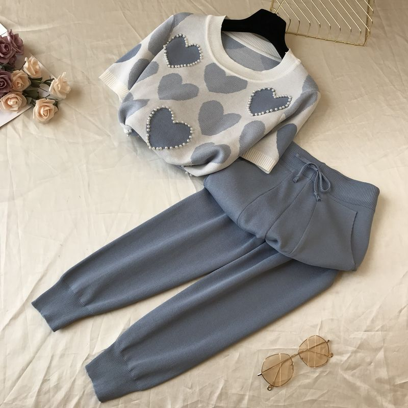 Primavera e verão feminino lazer moda fino tricô mangas curtas calças terno de duas peças