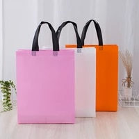 portable solid color shopping bags for women men simple non woven fabric clothing bags for travel easy to carry wholesale