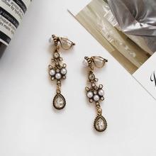 Corean Clip en los pendientes de diamantes de imitación Vintage Long Dangle Clip Earring no perforó las señoras Retro joyería para las mujeres envío gratis