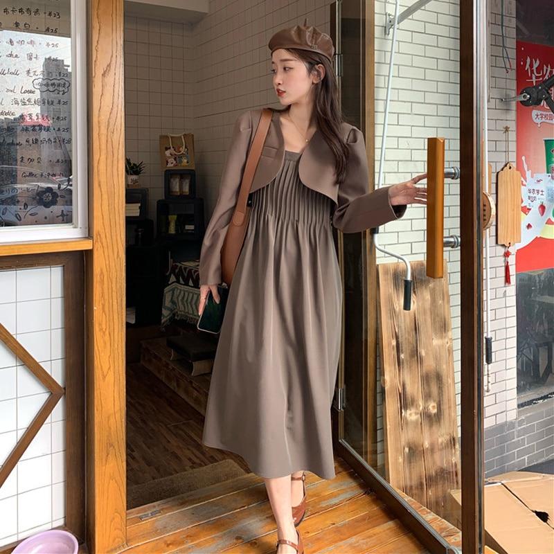 Uma peça vestido terno feminino outono 2021 novo design da minoria francesa pressão plissado cintura fina moda saia suspender