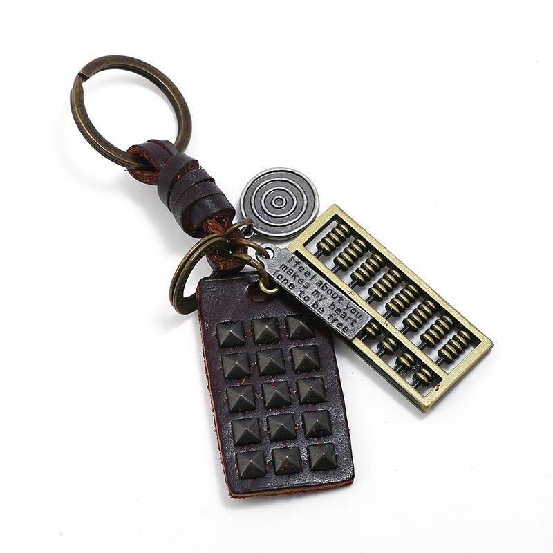 Vintage Retro llavero para hombre y mujer negro remache Ábaco colgante aleación anillo de cuero bolsa accesorios coche llavero regalo de joyería Casual
