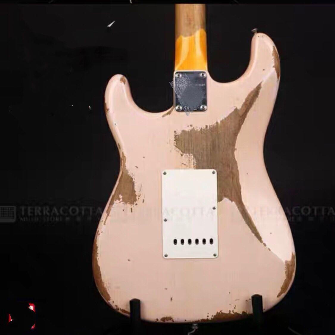 High quality Electric Guitar,rosewood fingerboard gitaar.relics by hands.relics pink color guitarra. enlarge