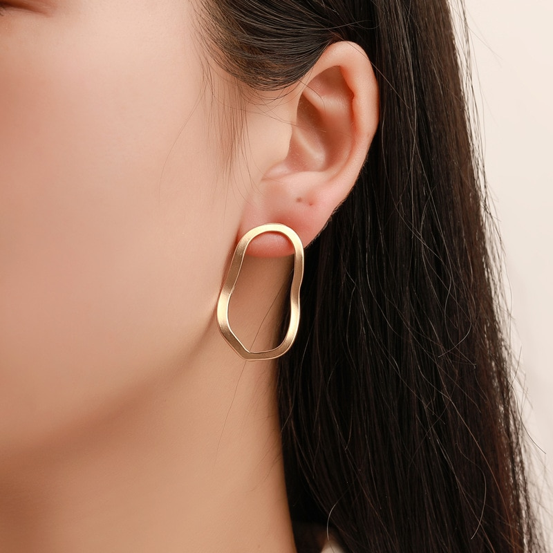 European and American exaggerated metal Akin earpiece geometric irregular hollow wave air ear ring pendant cross-border supply