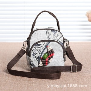 National style original hand woven Mini Mini hand-held, cross body single shoulder three use new ink light multi compartment bag