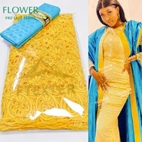yellow and sky blue guipure swiss voile lace in switzerland and bazin riche fabric for gambia fashion women wedding dry laces