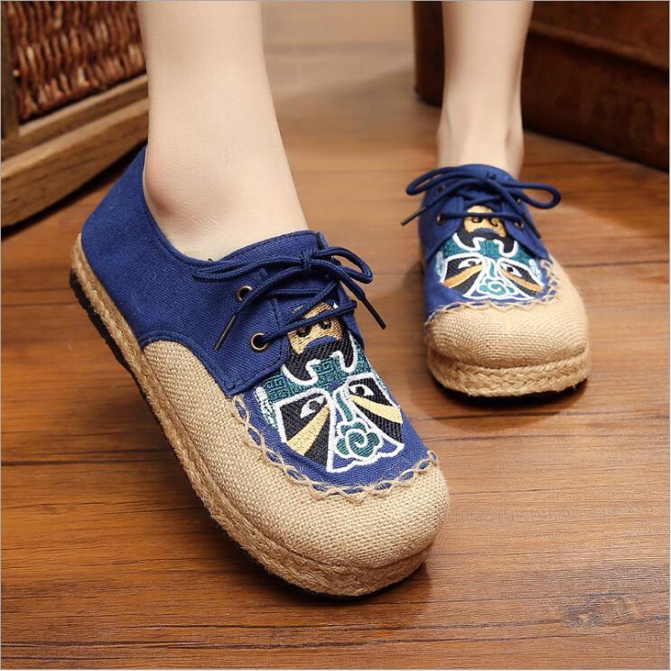 Par de zapatos de lino de estilo nacional de China, venta al por mayor, maquillaje facial de ópera de Beijing, zapatos de tela bordada antigua para mujer