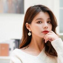Xinwei  temperament wild earrings for women personality simple white shell bag pendant earring jewelry gift