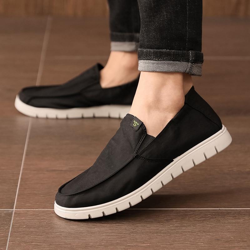 D134 Xinqing أحذية رجالي عادية القيادة عدم الانزلاق كعب أحذية الربيع والصيف شريط مرن الأحذية القماش