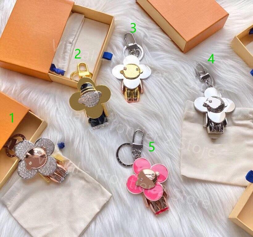 رائجة البيع الفاخرة أربع أوراق البرسيم القديمة زهرة معدنية فيفيان المفاتيح الشمس زهرة دمية حلقة رئيسية حقيبة الموضة تزيين مُثبت