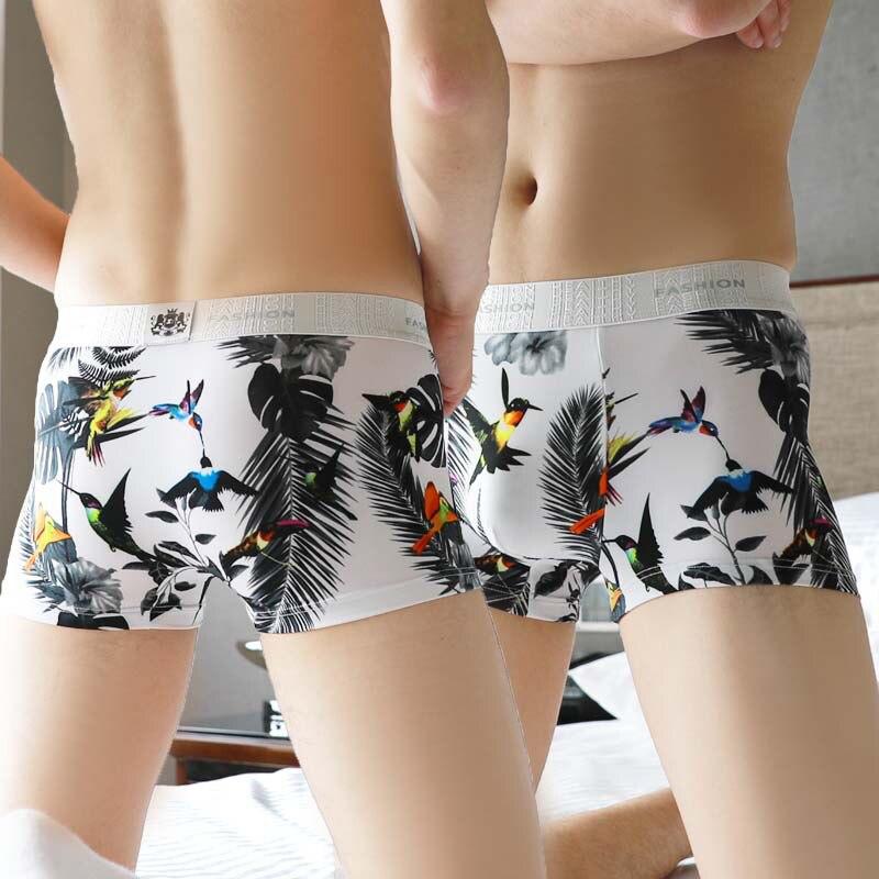 Ropa interior de seda de hielo de verano para hombres, calzoncillos Boxer sexis de cintura media cómodos y transpirables, pantalones cortos con personalidad juvenil estampados