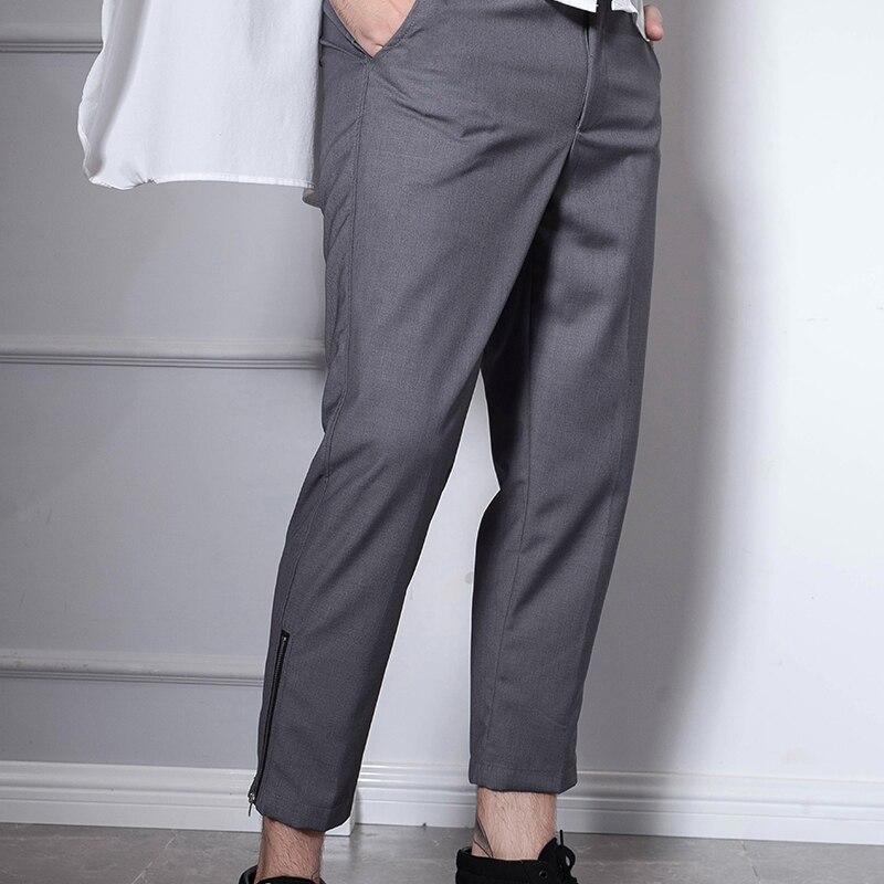 Versión japonesa y surcoreana de los pantalones de nueve puntos de moda de los hombres de cremallera Delgado pantalones casuales Corea del Sur gris casual otoño retr