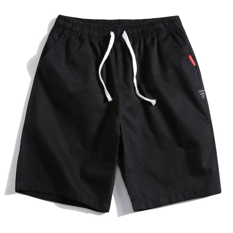 Verano nuevos pantalones cortos de algodón holgados casuales de hombre negro blanco cordón cintura sólida talla grande 4XL 5XL