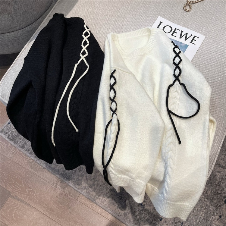 In autumn and winter of 2020, the new Korean version of the small fresh strap with round neck loose sweater top female F6875