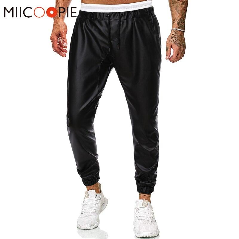 Pantalón bombacho de estilo harén de piel sintética negro de moda para hombre Parkour Hip Hop traingsbroek mannel de marca