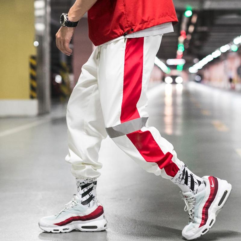 YASUGUOJI 2019, pantalones de Harem a rayas laterales para Hombre, pantalones de chándal reflectantes Pop a la cadera, ropa de calle, pantalones de moda informales para Hombre