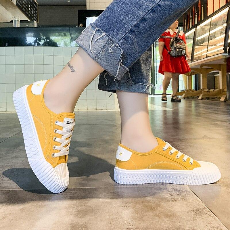 Zapatillas de mujer recién llegadas de moda con cordones negro blanco amarillo zapatos de mujer sólidos bajos zapatos de lona casual U12-22 Mujer