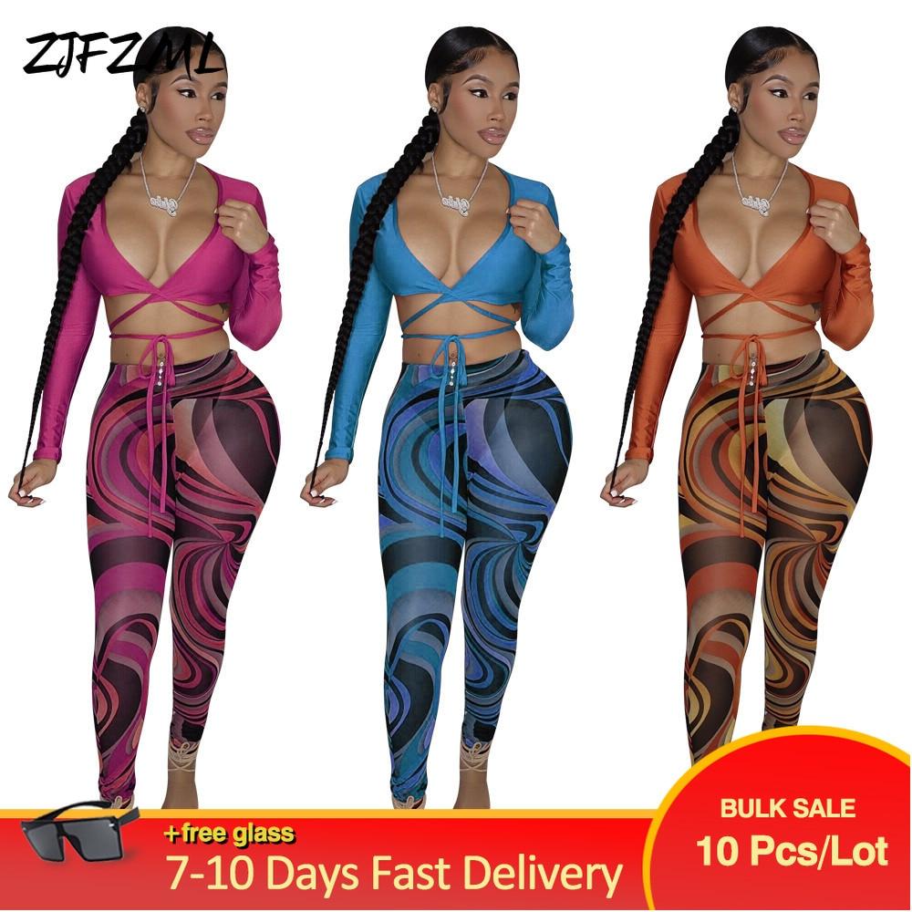 طقم ملابس رياضية للنساء مكون من قطعتين بجزء علوي ضيق وأكمام طويلة + بنطلون مطاطي عالي الخصر