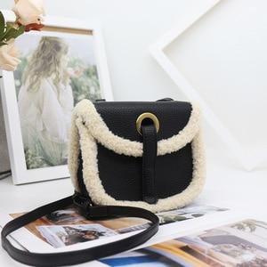 Lamb hair women's bag 2021 new style messenger bag semi round retro flip Korean single shoulder bag