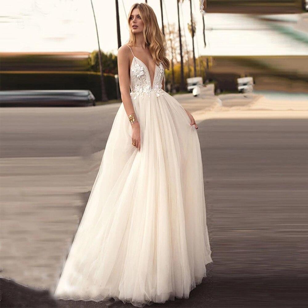Sexy Wedding Dresses V Neck Spaghetti Straps Lace Appliques Tulle Open Back A Line Sweep Train Bridal Gown Robe De Mariée Custom