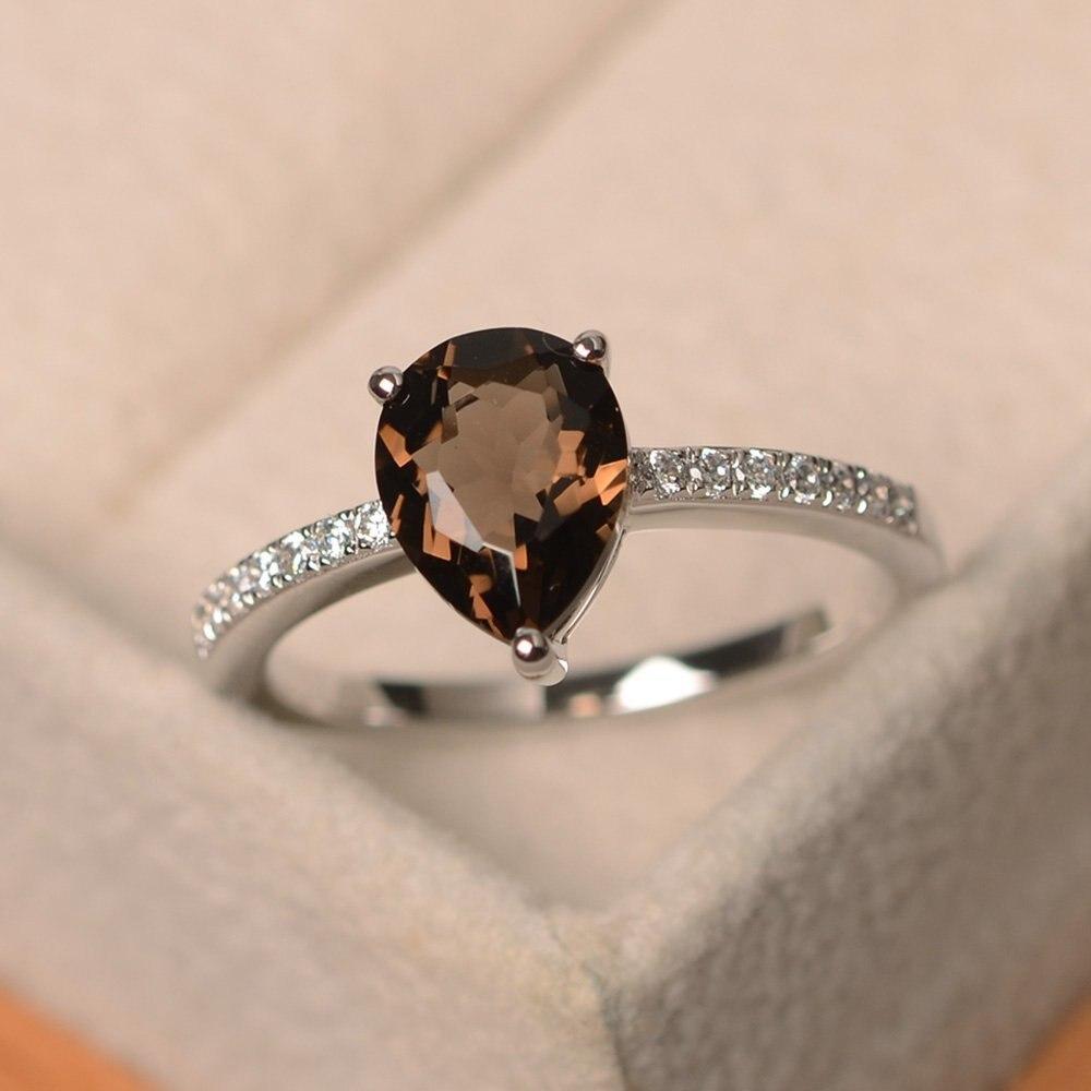 Europa y los Estados Unidos nuevo exquisito anillo Simple en forma de gota incrustado S925 plata esterlina marrón gema señoras temperamento anillo