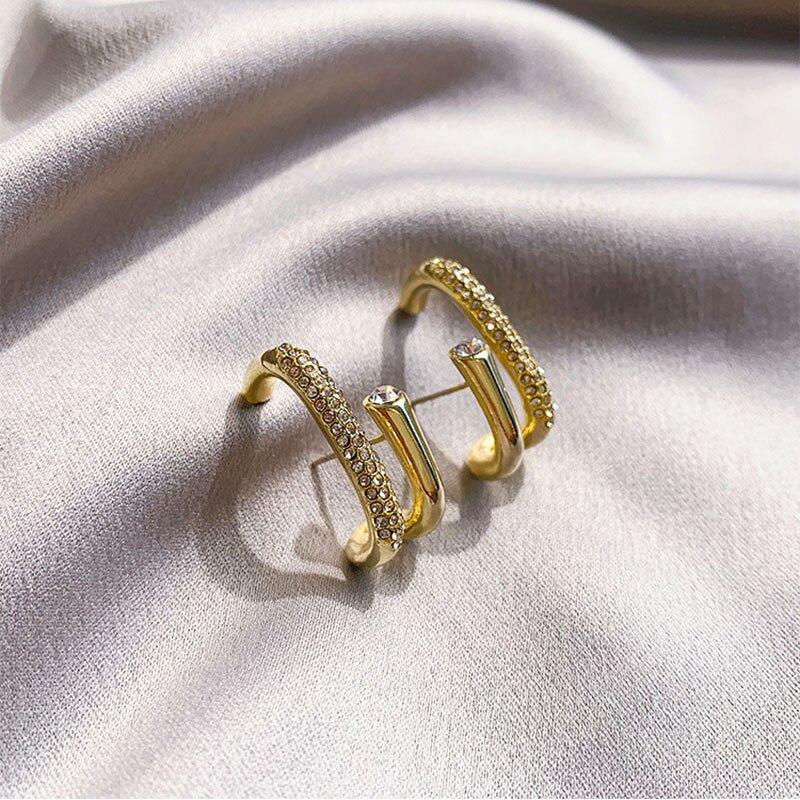 Irregular water drill rotating U-shaped earrings women's cold wind retro chic chic