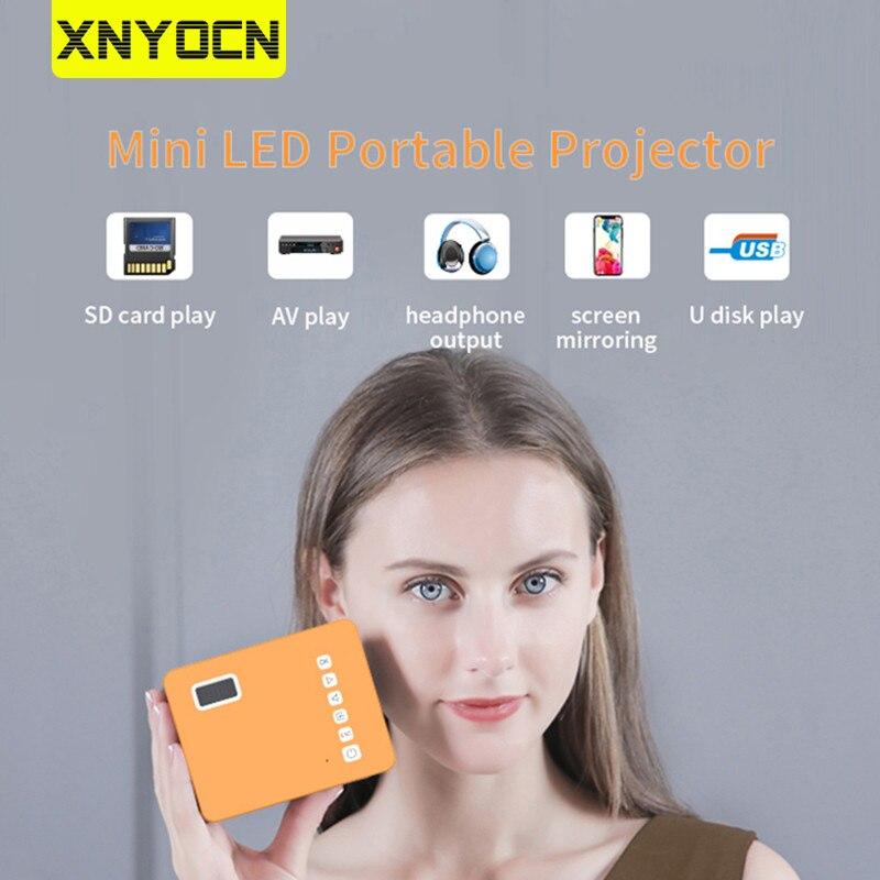 Xnyocn 2020 جديد HD جهاز عرض صغير 16.7 متر الصوت المحمولة العارض الرئيسية مشغل الوسائط الفيديو السينما المنزلية ثلاثية الأبعاد فيلم لعبة Proyector