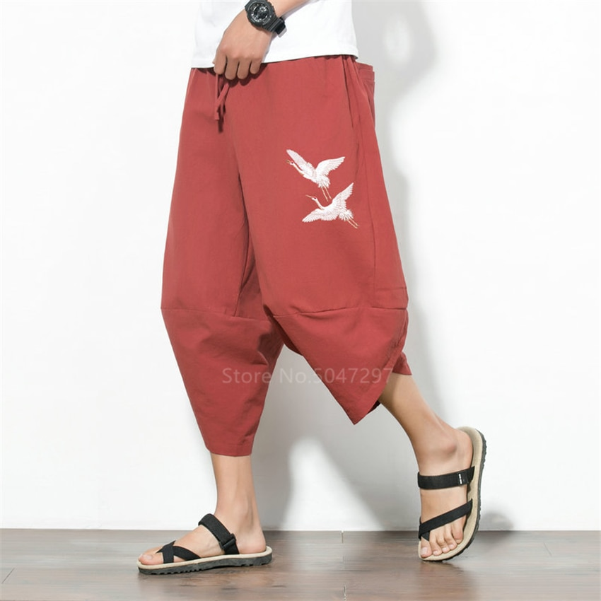 Pantalones Harem estilo japonés de talla grande pantalones de pierna ancha hombres disfraz de Samurai Crane bordado Vintage pantalones Haori Harajuku Asia