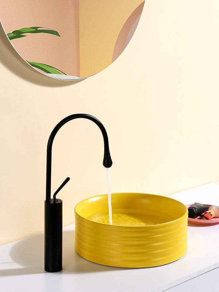 Estilo nórdico simple amarillo mate de cerámica redonda Sobre lavabo de encimera...