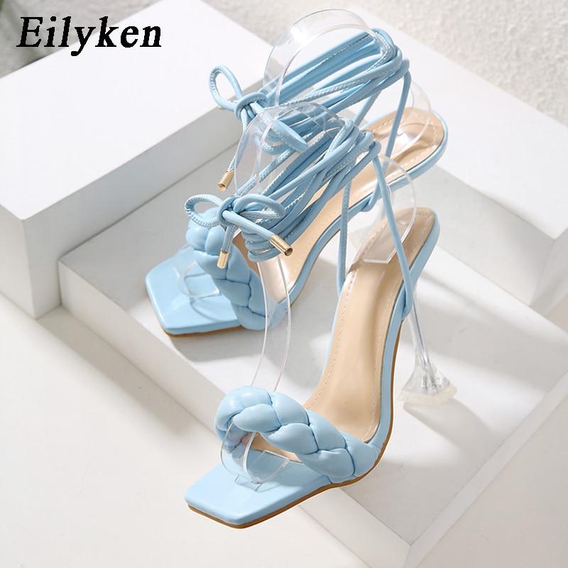 Eilyken 2021 جديد الصيف موضة تصميم نسج النساء الصنادل شفافة غريبة عالية الكعب صنادل سيدات المفتوحة حذاء مزود بفتحة للأصابع