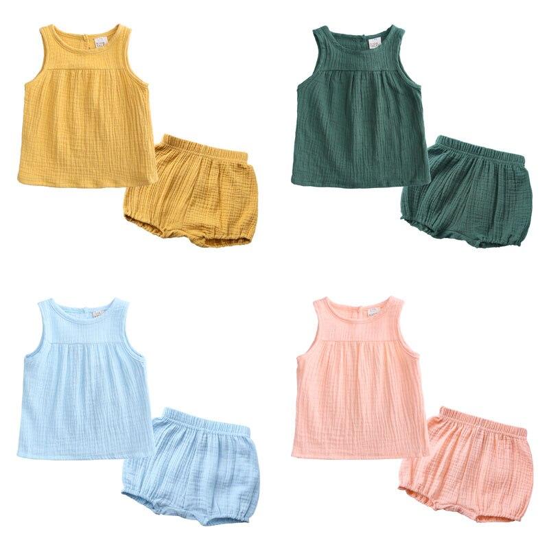 Moda Niño niña ropa de verano ropa de algodón de lino niños conjunto chaleco sin mangas + Pantalones cortos 2 uds ropa para niños conjunto 0-4 años