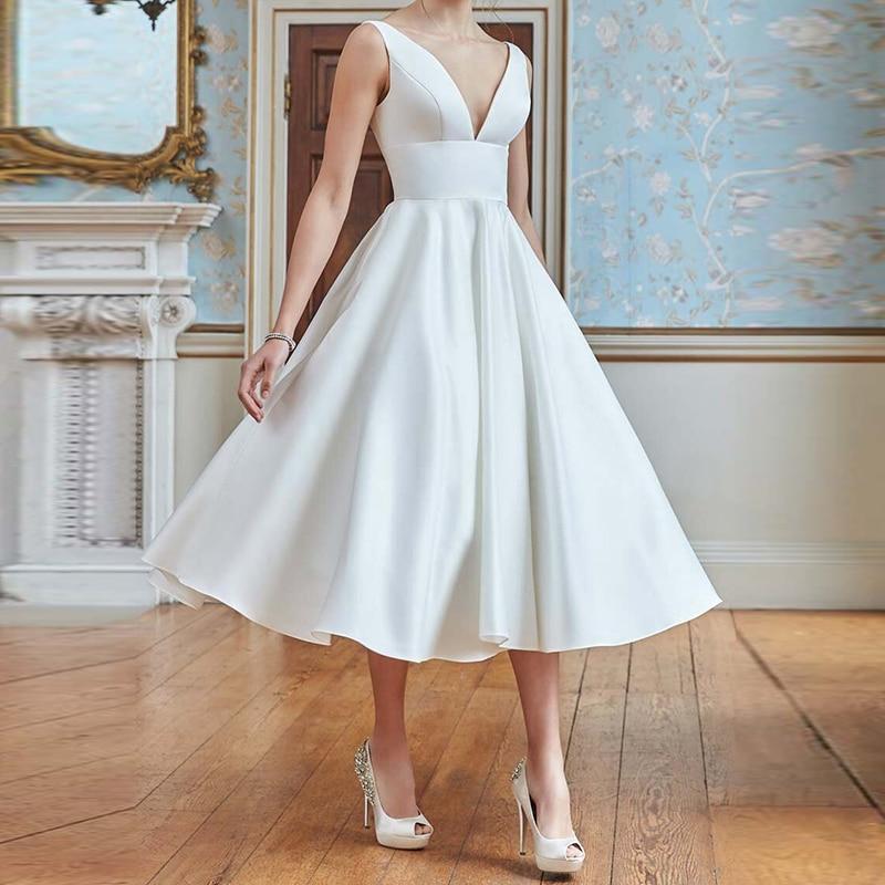 عارية الذراعين العميق الخامس الرقبة الأبيض تقسم فستان صيفي المرأة عطلة الشاطئ فستان مثير بلا أكمام أنيقة فساتين متوسطة الطول